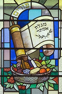 Stained glass depicting a Hebrew scroll and basket of fruit..